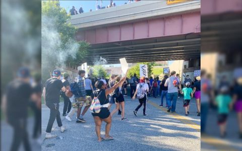 A crowd of protesters near the Interstate 244 overpass in Tulsa